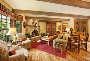 Country Living Room with Hardwood floors, stone fireplace, metal fireplace, Exposed beam