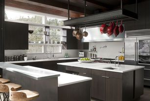 Contemporary Kitchen with limestone tile floors, Quartz counters, Arteriors Henson Counter Stool 6535, Kitchen island, Flush