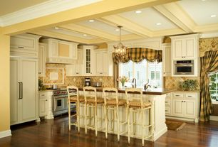 Traditional Kitchen with Wood counters, Casement, Simple granite counters, Breakfast bar, Pendant light, full backsplash