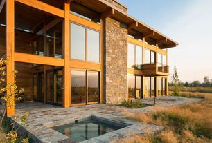Contemporary Hot Tub with exterior stone floors, Pathway