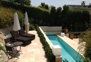 Modern Swimming Pool with exterior stone floors, Fence, Raised beds, Lap pool