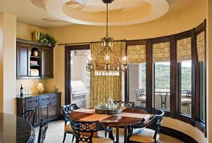 Modern Dining Room with Built-in bookshelf, Concrete tile , Chandelier, French doors, picture window, Standard height