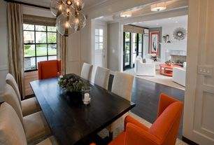 Contemporary Dining Room with Pendant light, Wainscotting, Home decorators collection parsons side chair, Starburst mirror