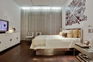 Contemporary Master Bedroom with can lights, Built-in bookshelf, Standard height, Hardwood floors