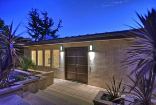 Contemporary Front Door with Raised beds, exterior tile floors