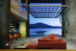Contemporary Living Room with specialty door, High ceiling, Indoor/outdoor living, Concrete floor, interior brick, Carpet