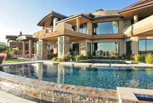 Contemporary Exterior of Home with Stone walkway, Pool with hot tub, Exterior stucco walls