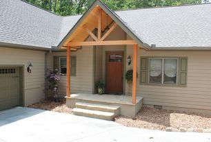 Craftsman Front Door with six panel door, double-hung window, exterior stone floors