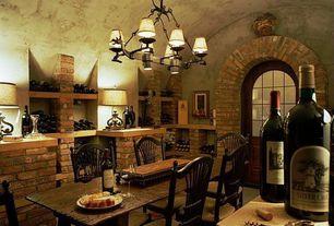 Mediterranean Wine Cellar with Chandelier, Emerald Home Ashland Trestle Base Dining Table, Glass panel door, interior brick