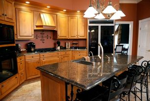 Traditional Kitchen with Kitchen island, Woodland Imports Metal Wall D?cor, Raised panel, Simple Granite, Undermount sink