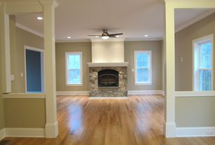 "Traditional Living Room with Frisco 52"" ac motor ceiling fan with light - matte black, Crown molding, Hardwood floors"