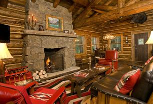 Rustic Living Room with Exposed beam, Fireplace, High ceiling, Marc taggart & company burl club chair, Hardwood floors