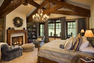 Rustic Master Bedroom with Stacked stone wall, Bourdonnais Double Bookcase Tall, Arm swing sconce, Chandelier, Carpet