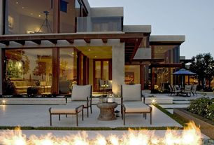 Contemporary Patio with Outdoor seating area, Trellis, French doors, Raised beds, Fire pit, Glass door, Natural light