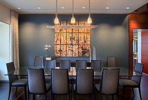 Contemporary Dining Room with Pendant light, Laminate floors