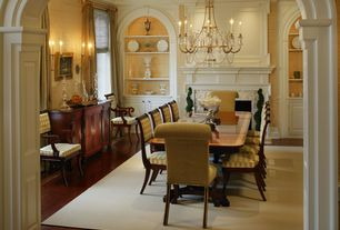 Traditional Dining Room with Wall sconce, High ceiling, Hardwood floors, Chandelier, Crown molding