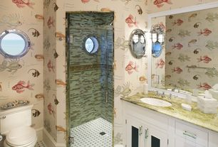 Traditional 3/4 Bathroom with complex marble tile counters, Handcrafted model ships porthole mirror, Undermount sink