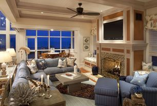 Eclectic Living Room with Cement fireplace, Rowe Furniture Townsend Sectional, Laminate floors, Urbia Mixx Una Coffee Table