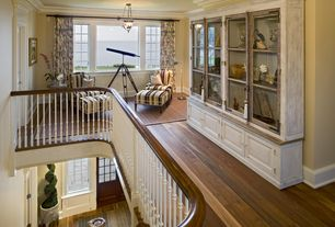 Traditional Hallway with Hardwood floors, Standard height, can lights, Built-in bookshelf, picture window, Crown molding
