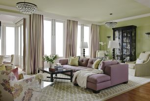 Contemporary Living Room with Hardwood floors, Standard height, Crown molding, Chandelier, Wall sconce, French doors