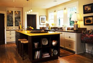 Traditional Kitchen with Built-in bookshelf, can lights, Casement, Pendant light, flat door, Glass panel, partial backsplash