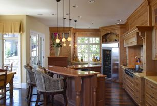 Traditional Kitchen with Kitchen island, Pendant light, Breakfast bar, Custom hood, Flat panel cabinets, Glass panel