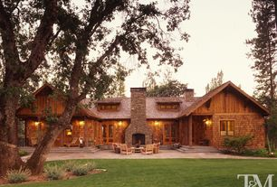 Rustic Exterior of Home with Cedar shingle siding, Outdoor stone fireplace