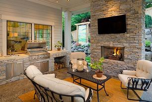 Traditional Porch with Outdoor kitchen, Fence, picture window, Screened porch