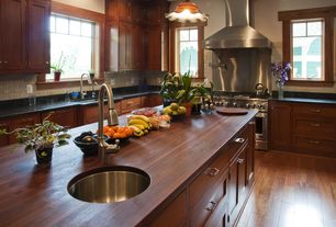 Traditional Kitchen with Wall Hood, Undermount sink, Slate Tile, Pendant light, Casement, double oven range, Stone Tile