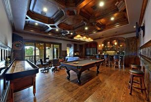 Traditional Game Room with Wainscoting, Balcony, Pool table, Shuffleboard table, Pendant light, Built in entertainment center