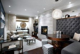 Contemporary Great Room with metal fireplace, Fireplace, Standard height, Crown molding, can lights, Pendant light