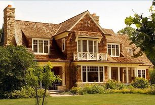Traditional Exterior of Home with Lawn, Exterior stone chimney, Cedar shingle siding, Chimney, Balcony