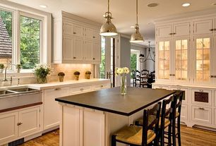 Traditional Kitchen with Stone Tile, Flat panel cabinets, Glass panel, French doors, Farmhouse sink, High ceiling, L-shaped
