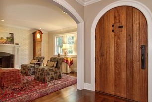 Eclectic Entryway with Crown molding, Hardwood floors