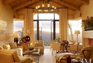 Contemporary Living Room with Fireplace, High ceiling, picture window, Transom window, Chandelier, Exposed beam, Carpet