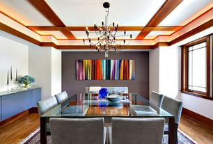 Contemporary Dining Room with Crown molding, Built-in bookshelf, Chandelier, Hardwood floors