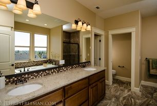 Craftsman Master Bathroom with Glomar 3-light old bronze vanity with alabaster glass bell shades, framed showerdoor, Shower
