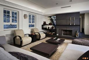 Contemporary Living Room with Crown molding, Laminate floors