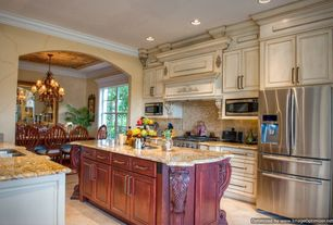 Traditional Kitchen with Kitchen island, Crown molding, Simple granite counters, Built In Refrigerator, One-wall, Custom hood