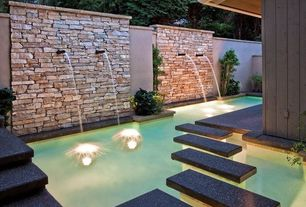 Contemporary Swimming Pool with Sandstone bricks, Exposed stone wall, Fountain, Custom Pool Water Feature, Fence, Pathway