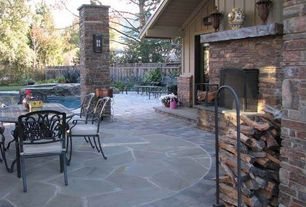 Country Patio with Fence, French doors, exterior stone floors
