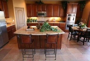 Traditional Kitchen with full backsplash, Built In Refrigerator, Breakfast nook, built-in microwave, L-shaped, six panel door