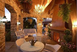 Country Patio with Resin wicker patio set, Hanging plants, Paint, Chandelier, Patio furniture, Exposed beam