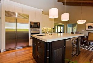 Contemporary Kitchen with Ultracraft Destiny Plainview Cabinetry, One-wall, Kitchen island, Simple marble counters