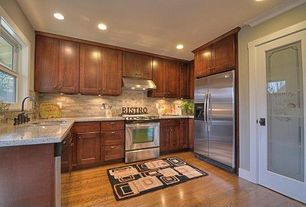 Traditional Kitchen with U-shaped, dishwasher, Casement, Crown molding, drop-in sink, Large Ceramic Tile, gas range