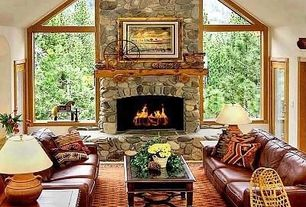 Tropical Living Room with Eldorado Stone Montana Top Rock, stone fireplace, Carpet, French doors, High ceiling