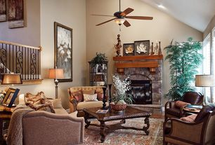 Traditional Living Room with Chandelier, Fireplace, double-hung window, stone fireplace, High ceiling, can lights