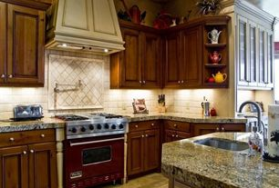 Traditional Kitchen with Large Ceramic Tile, Framed Partial Panel, gas range, limestone tile floors, Raised panel, can lights