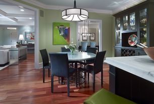 Contemporary Dining Room with Crown molding, Laminate floors, Pendant light
