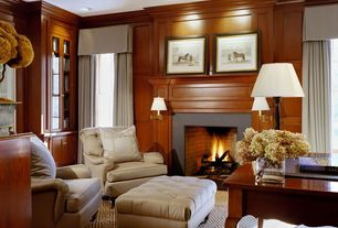 Traditional Living Room with Robery Abbey Kinetic Brass Wall Sconce, Built-in bookshelf, Carpet, Wainscoting